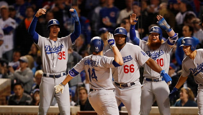 Enrique Hernandez celebrates after hitting a grand slam in the third inning.