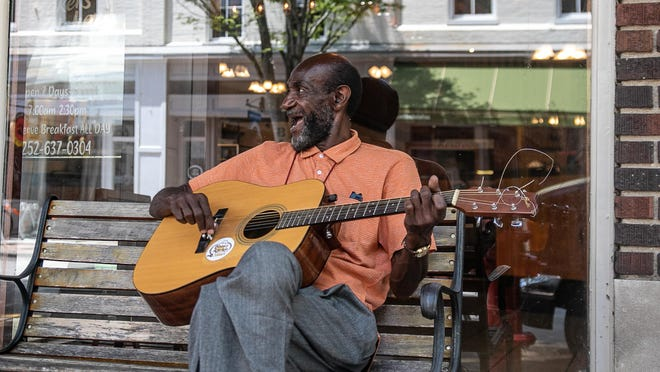 Howard Matthews can often be found entertaining passers-by on Middle Street in New Bern.