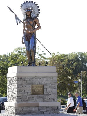 """The bronze statue """"He Who Walks with Thunder"""" stands on a pedestal in downtown Menasha. The statue was commissioned by businessman John Bergstrom and created by sculptor David Spellerberg."""