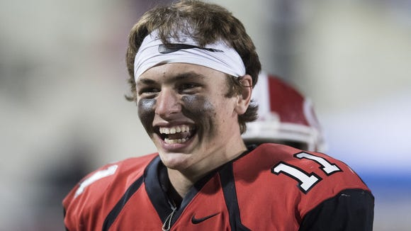 Greenville quarterback Davis Beville was all smiles here during the Red Raiders' Week 9 victory over Daniel, as well as three days later when he received a scholarship offer from the University of Pittsburgh.