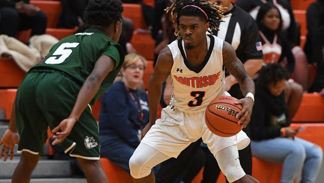 Southside senior Tuzion Brock (3), shown in an earlier game, had 16 points and seven assists in the Tigers' 57-44 win over Pendleton Friday night.