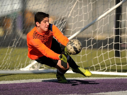 Wylie's Cameron Dawsey (0) saves a ball during the penalty kicks in the Bulldogs' win on Friday, March 17, 2017, at Wylie's Bulldog Stadium.