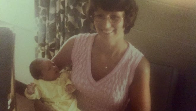 A family snapshot shows Nancy Watts holding Brad Watts, the newborn son she adopted, in 1975. Nanci Watts this year was able to meet the woman who birthed her son thanks to a change in Ohio law.
