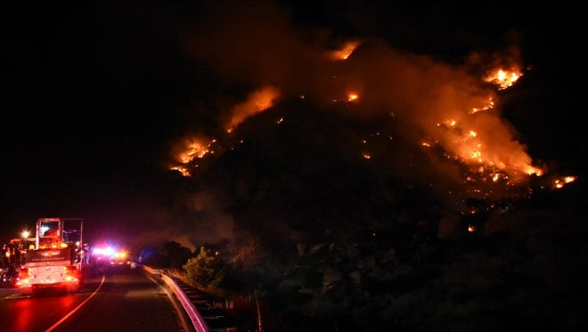 Crews were battling a brush fire on the hillside near Highway 118 in Simi Valley on Saturday after a car crash sparked the blaze.