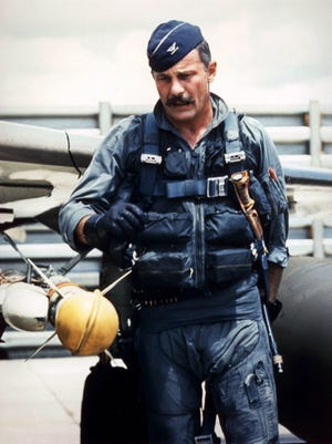 Brig. Gen. Robin Olds pre-flights his F-4C Phantom before a combat mission in Southeast Asia, circa Sept 1967, while serving as the Commander of the 8th Tactical Fighter Wing at Ubon Air Base, Thailand.