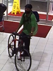 Police are asking for help in identifying a man who rode his bike into an east-side laundromat and stabbed a woman Tuesday night.