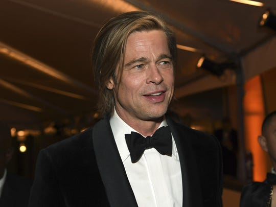 """Brad Pitt, winner of the award for best performance by an actor in a supporting role for """"Once Upon a Time in Hollywood,"""" attends the Governors Ball after the Oscars on Sunday, Feb. 9, 2020, at the Dolby Theatre in Los Angeles. (Photo by Richard Shotwell/Invision/AP)"""