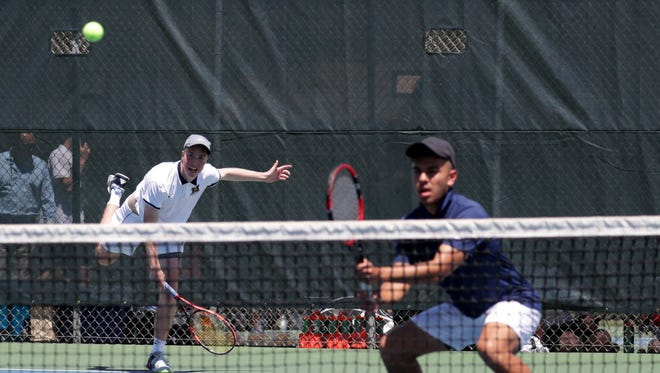 The Marquette doubles team of Rob May (left) and Noah Guillermo play a match against Whitefish Bay's Jack Lyons and Jacob Gurican   in the Greendale Sectional Wednesday.