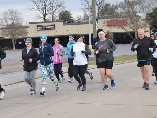 A group of about 13 runners led by Ronnie Schwartz (front, far right) take off from the Louisiana Athletic Club in Alexandria for an eight-mile run on Saturday. The group usually meets on Tuesdays, Thursdays and Saturdays for runs.