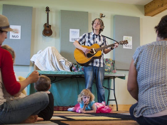 Chris Dorman leads a circle of young children and parents in song at Music for Sprouts in Shelburne on Friday, May 20, 2016. Music for Sprouts is one of several small enterprises under one roof at Bread and Butter Farm.