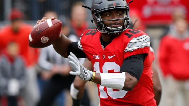 Ohio State quarterback J.T. Barrett drops back to pass against Michigan during a game in Columbus, Ohio on Nov. 26.