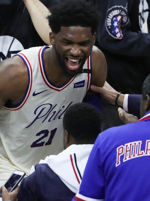 Sixer Joel Embiid celebrates after the Sixers' 104-91 win in game five of an opening-round playoff series at the Wells Fargo Center in Philadelphia on April 24.