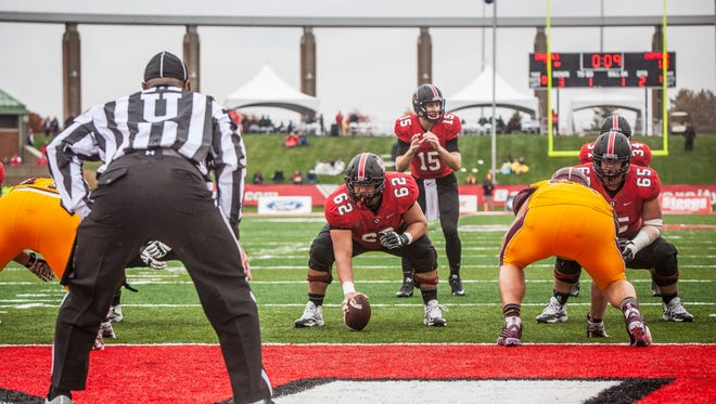 Jacob Richard sets the snap for Ball State Saturday as Central Michigan attempts to stop the touchdown. Ball State lost 23-21.
