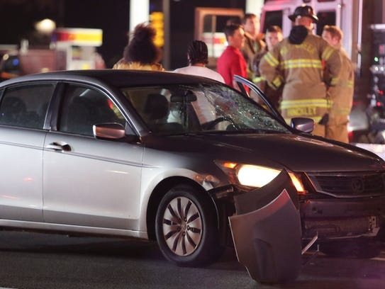 Police and emergency personnel work at the scene of the accident involving Aquisha Williams on Kirkwood Highway on May 11. She was struck on eastbound Kirkwood Highway near the intersection with Duncan Road about 9 p.m.
