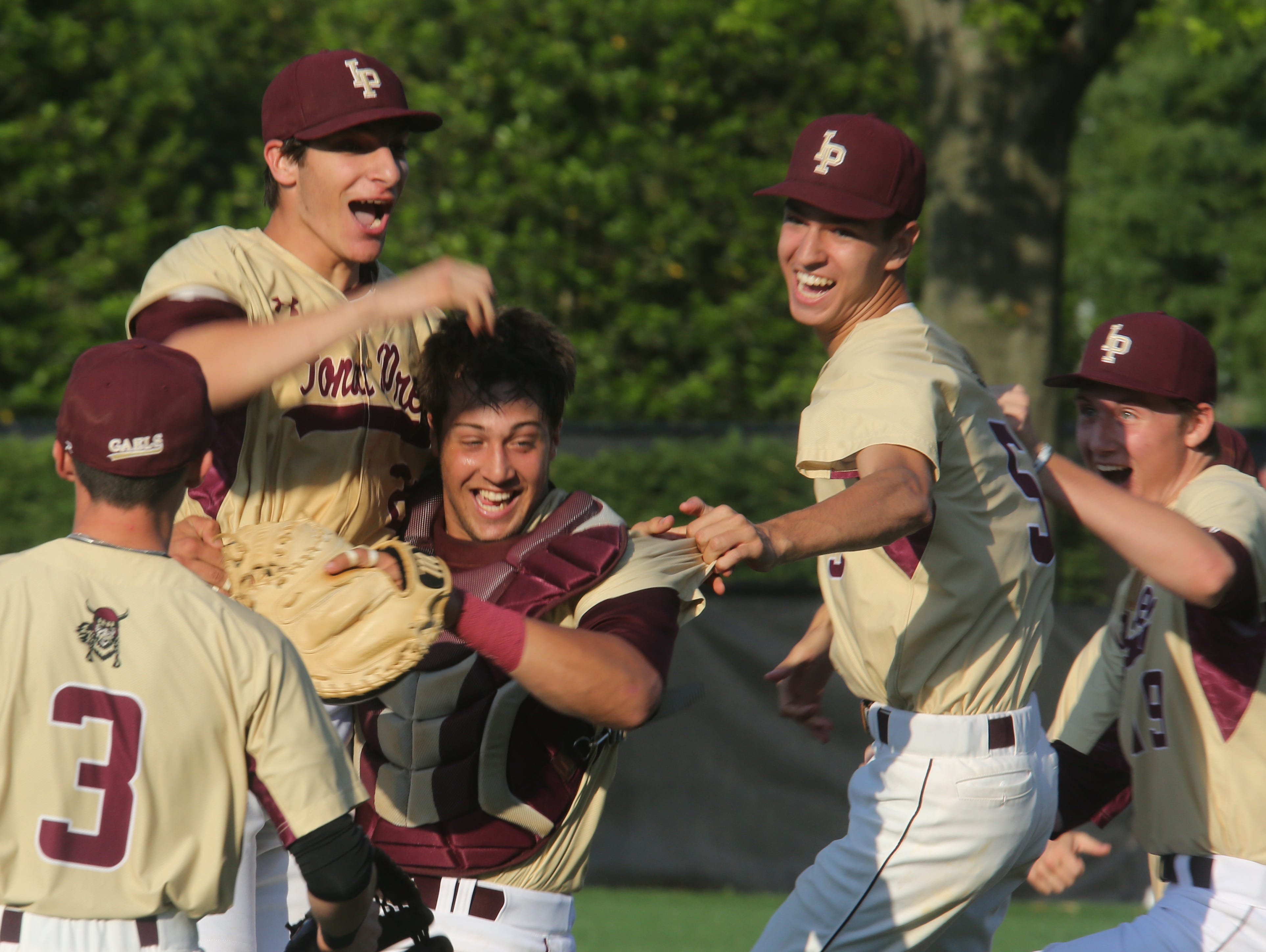 Iona Prep celebrates their 4-0 win over Xaverian during CHSAA baseball playoffs at Fordham University in Bronx on June 1, 2016.