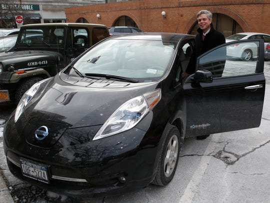 White Plains Mayor Tom Roach with his own personal car, a Nissan Leaf, parked outside White Plains City Hall on Feb. 19.