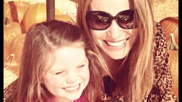 Melissa Mazzella DeLaney with her daughter.
