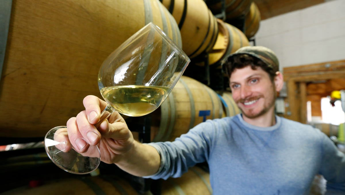 Ben Riccardi, owner/winemaker of Osmote Wine checks his Chardonnay at Damiani Wine Cellars, where he makes his wines.