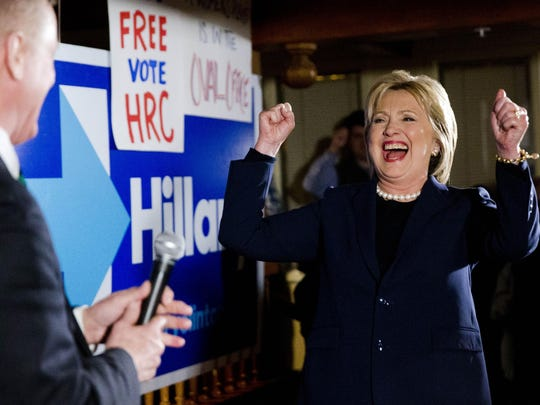 Democratic presidential candidate Hillary Clinton reacts as she is introduced to supporters by former Vermont Gov. Howard Dean after taking part in the debate Thursday in Durham, N.H.