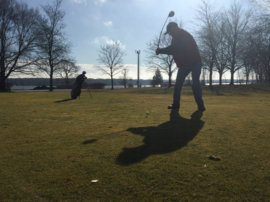 Marysville resident John Knuth readies to take a practice swing at the city's public golf course on Wednesday, Feb. 3, 2016.
