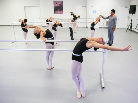 Students at Gulfshore Ballet work at the barre during