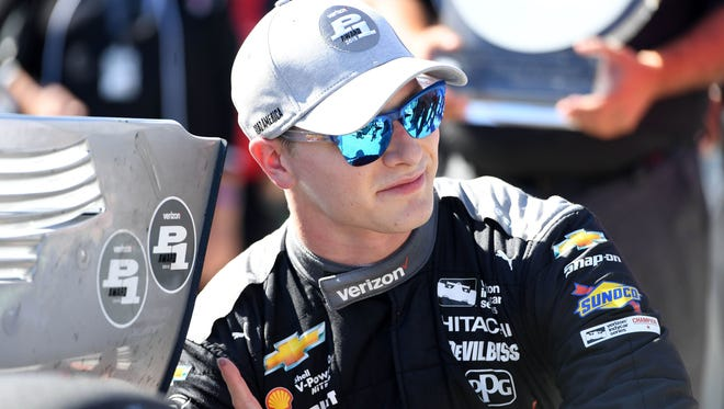 Verizon Indy Car driver Josef Newgarden (1) reacts after winning the pole award for the Kohler Grand Prix at Road America. Mandatory Credit: Mike DiNovo-USA TODAY Sports