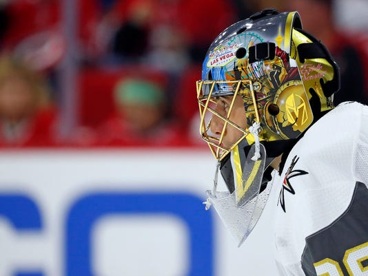 Vegas Golden Knights goaltender Marc-Andre Fleury (29) watches the second period of an NHL hockey game against the Carolina Hurricanes, Sunday, Jan. 21, 2018, in Raleigh, N.C. (AP Photo/Karl B DeBlaker)
