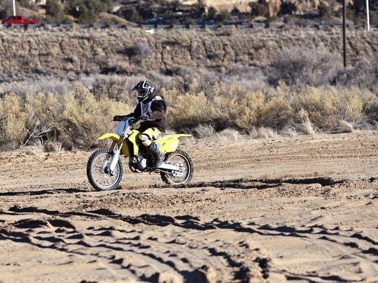 Kevin Wood rides his Suzuki 450 in the Glade Run Recreation Area on March 3, 2010.