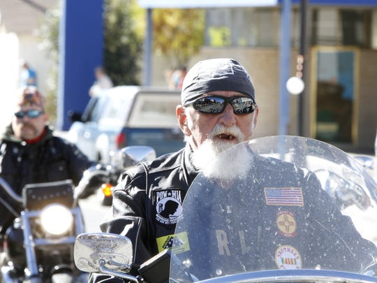 Patriot Guard Riders cruise down Main Avenue in Aztec to pay respect to veterans on Nov. 8, 2014, during the Veterans Day parade.
