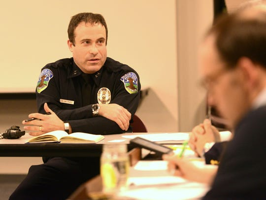 Burlington Police Chief Brandon del Pozo speaks with police commissioners at the Burlington Police Department on Tuesday.