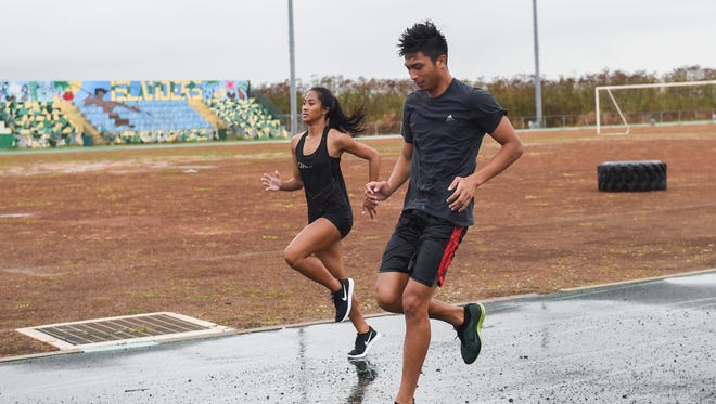 Guam Central Athletics team members Daelan Alviz, right, and Regine Tugade, left, warm up at the John F. Kennedy High School Track in Tamuning on June 21. A Guam Central Athletics team competes in the Hong Kong Inter-City Athletics Championships 2016 this weekend.