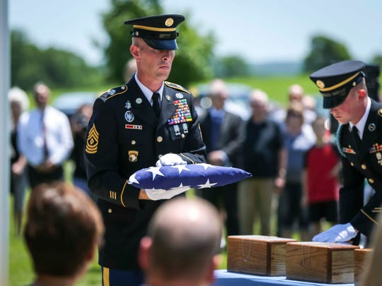 An Honor Guard folds the American Flag for the remains of three veterans at the Iowa Veterans Cemetery near Van Meter, Friday, July 6, 2018. Marine veteran John Joseph Fernandez, Jr., Army veteran Raymond Hines, and Army veteran James W. Watson were laid to rest during a ceremony at the Iowa Veteran's Cemetery after their cremated remains were left unclaimed at Hamilton's Funeral Home in the Des Moines area.