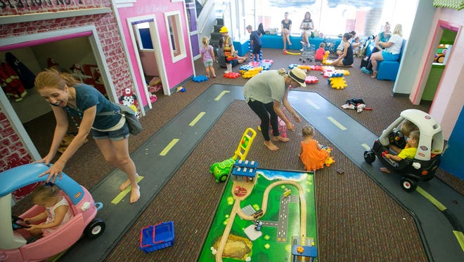 Kids play in the mini-neighborhood at Imagination Avenue in Phoenix.