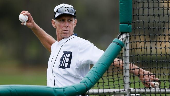Detroit Tigers special assistant to the general manager Alan Trammell throws batting practice  at spring training Feb. 26, 2015, in Lakeland, Fla.