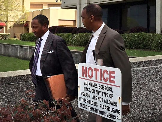 This file photo shows Artie Fletcher, right, leaving federal court in March with attorney Clarence Roby Jr. after Fletcher and the Rev. Kenneth Fairley were arraigned.