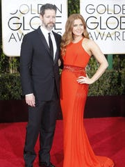 Amy Adams and her date arrive at the 73rd Annual Golden Globe Awards show at the Beverly Hilton Hotel in Beverly Hills, Calif., on Sunday, Jan. 10, 2016.