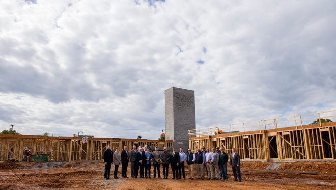 Developers, architect engineers, contractors, city officials and property manager gather outside the construction at 608 Main on October 25, 2017.