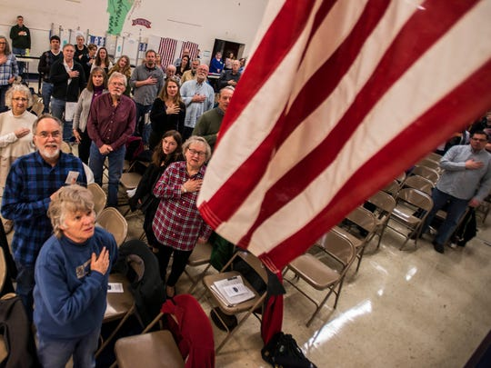 Residents turn to the American flag for the Pledge