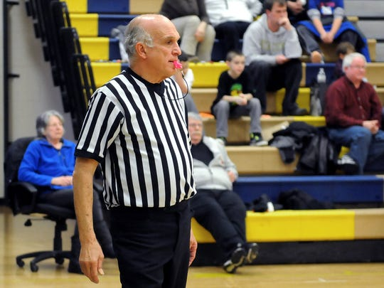Bill Green, 69, of Wappingers Falls, has been a referee for 32 years. He is pictured refereeing a Beacon High School girls basketball game earlier in the year.