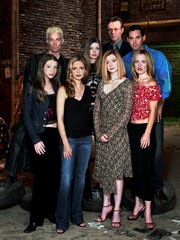 """TV-BUFFYRETURNS: The cast members of """"Buffy: The Vampire Slayer"""" on the UPN network are Michelle Trachtenberg, left to right, James Marsters, Sarah Michelle Gellar, Amber Benson, Anthony Stewart Head, Alyson Hannigan, Nicholas Brendon, and Emma Caulfield. (Gannett News Service/UPN) ORG XMIT: GPN3"""