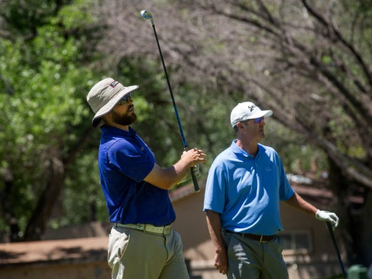 Andy Connell, left, and Scott Peterson tee off on the