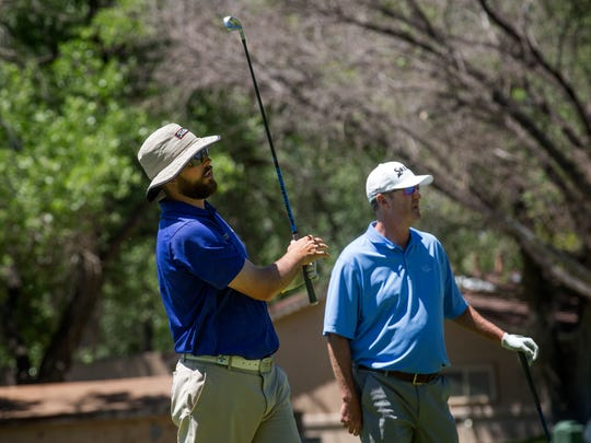 Andy Connell, left, and Scott Peterson tee off on the ninth hole during the second round of the San Juan Open on Friday at the San Juan Country Club in Farmington.