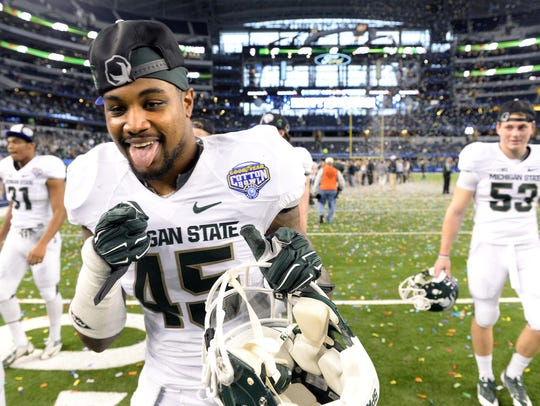MSU linebacker Darien Harris celebrates with the team