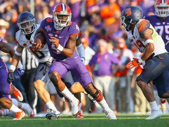 Clemson quarterback Deshaun Watson (4) runs by Syracuse defensive back Daivon Ellison (19) for a first down during the second quarter on Saturday November 5 at Memorial Stadium in Clemson.