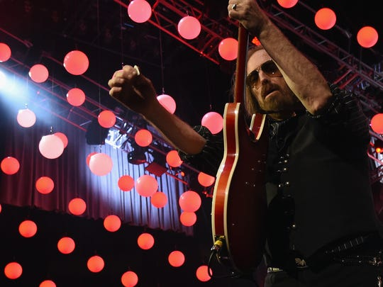 Tom Petty and the Heartbreakers perform during their 40th anniversary tour in Nashville in April.