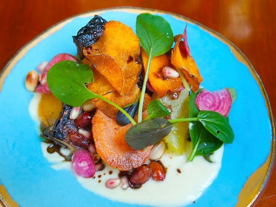 610 Magnolia's roasted garden root vegetables with sweet potato, sorghum vinaigrette, peanuts, beets, sunchoke, celery root and pomegranate seeds. The vegetables are grown at the restaurant. Oct. 3, 2017