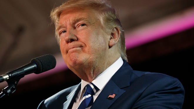 Republican presidential candidate Donald Trump pauses while speaking at a campaign rally, Friday, Oct. 28, 2016, in Manchester, N.H. (AP Photo/ Evan Vucci)