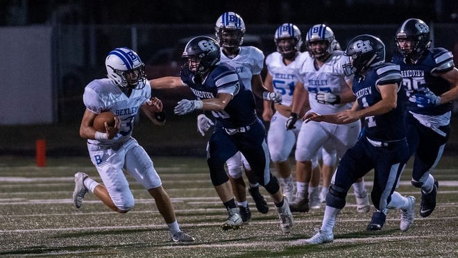 Bexley quarterback Tommy Bloebaum carries the ball against Grandview last season.