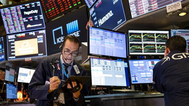 Trader Gregory Rowe works on the floor of the New York Stock Exchange at the end of the trading day March 16. Stocks are drifting between small gains and losses in early trading on Wall Street, Tuesday, a day after a broad rally.