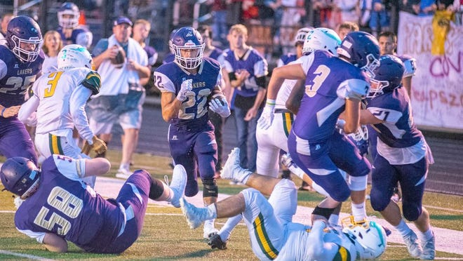 Camdenton senior Jadin Faulconer rushes through a sea of teammates and opponents in an attempt to reach the endzone agains the Parkview Vikings.